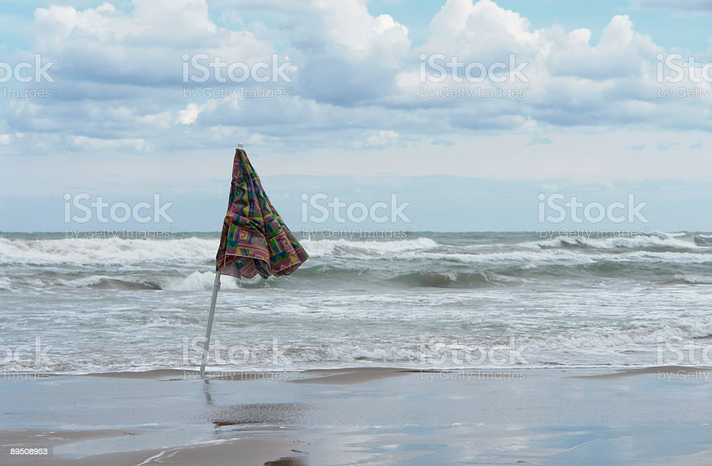 closed sunshade and deserted beach royalty-free stock photo
