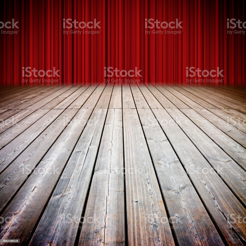 Closed theater red curtains and wooden floor against a cloudy sky - concep timage stock photo