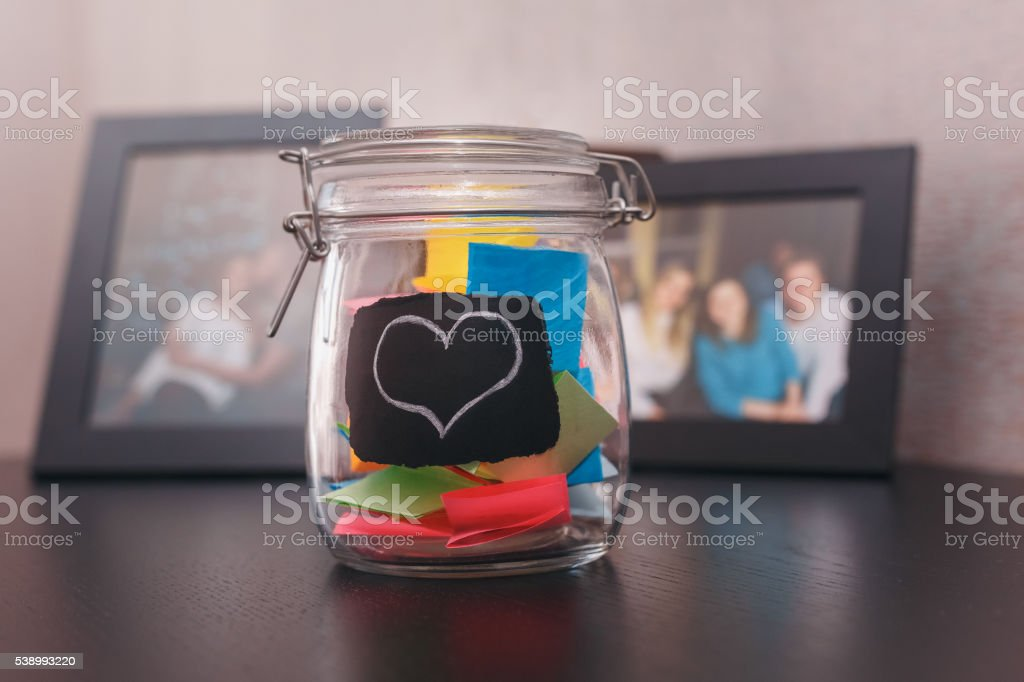 closed tin stickers inside with a painted heart stock photo