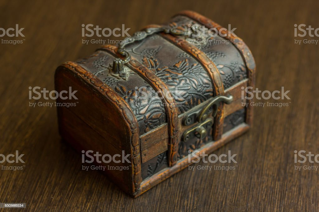 closed treasure chest on wooden table stock photo