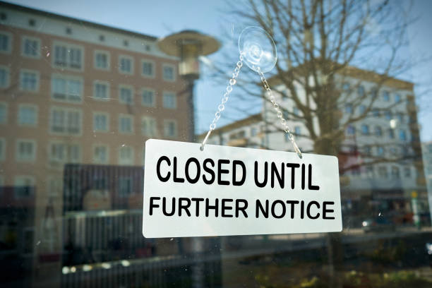 closed until further notice Sign on a shop window with the inscription closed until further notice information sign stock pictures, royalty-free photos & images