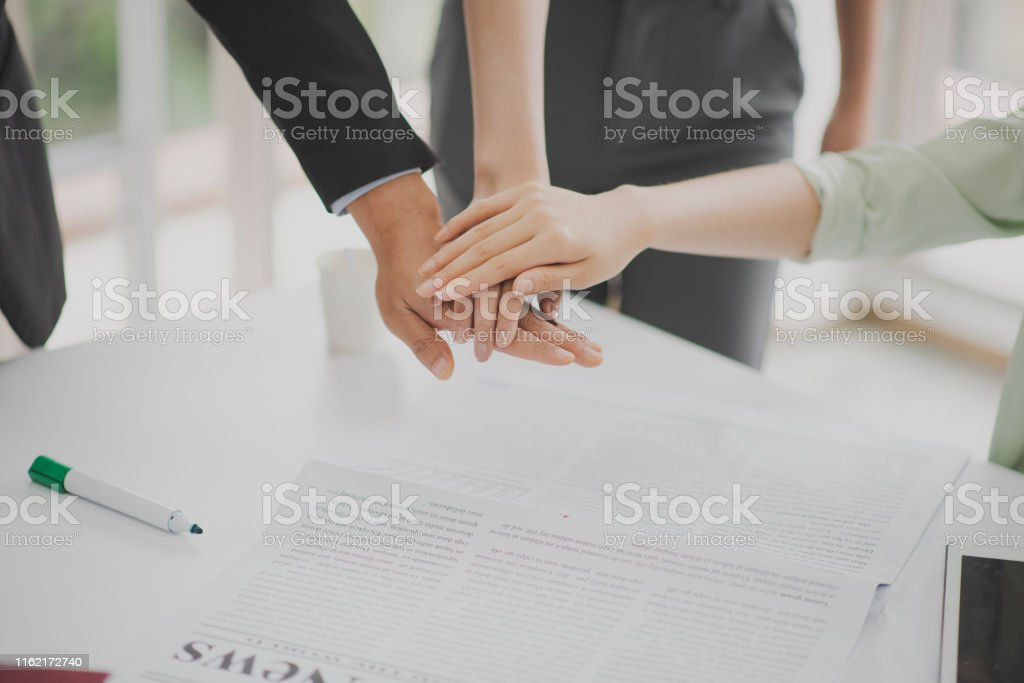 Closed up for 3 business peoples are standing and join hand near the...