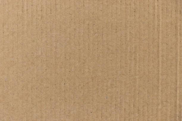 bruine kleur gegolfd papier bestuur achtergrond gebruikt als behang, decoratie, ontwerpelement sloot - bordpapier stockfoto's en -beelden