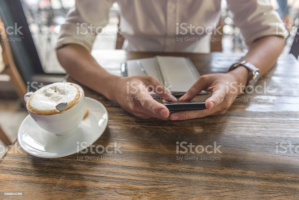 Closed up of human hand using smartphone for work stock photo