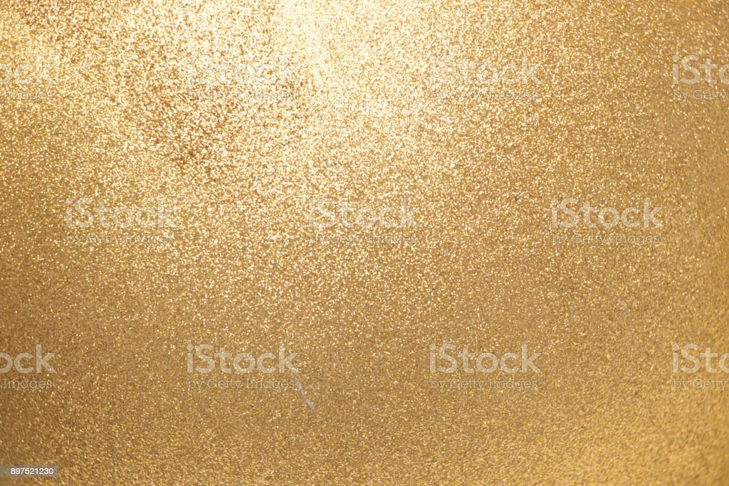 Closed up of metallic gold glitter textured background stock photo