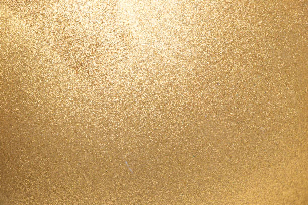 closed up of metallic gold glitter textured background - scintillante foto e immagini stock