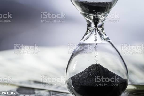 Closed up of sand falling in sandglass or hourglass on us dollar as picture id939841380?b=1&k=6&m=939841380&s=612x612&h=gths9pozkiwvc3qssgnqgmngrnae5zsfckoqua2ub o=
