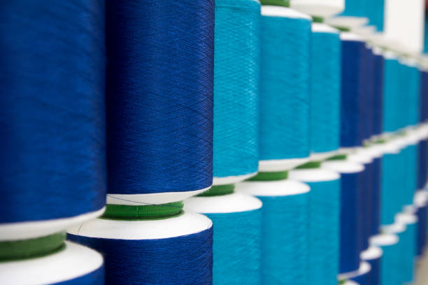 closed up of vairous blue color thread reel background - embroidery machine stock pictures, royalty-free photos & images