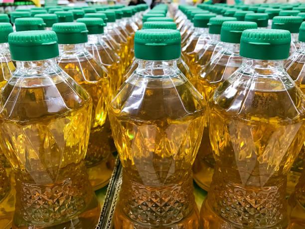 closed up pile of bottled palm oil - palm oil bottles imagens e fotografias de stock