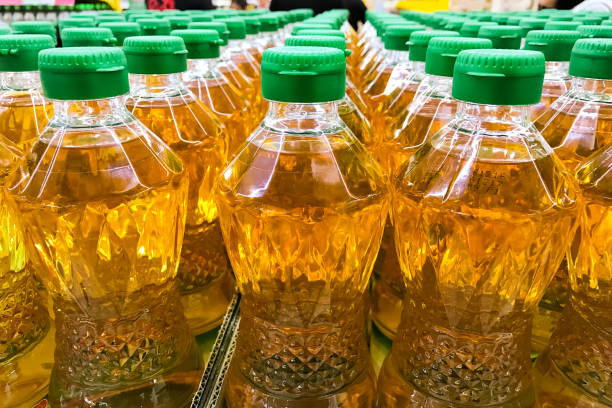 Closed up pile of bottled palm oil stock photo