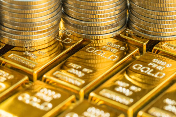 closed up shot of shiny gold bars with stack of coins as business or financial investment and wealth concept - wildlife reserve stock pictures, royalty-free photos & images