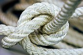 Closed up white twisted rope and knot.