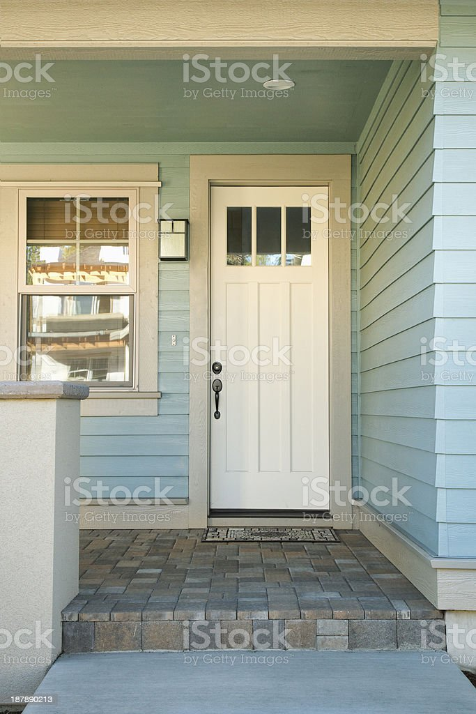 Closed white door of a home stock photo