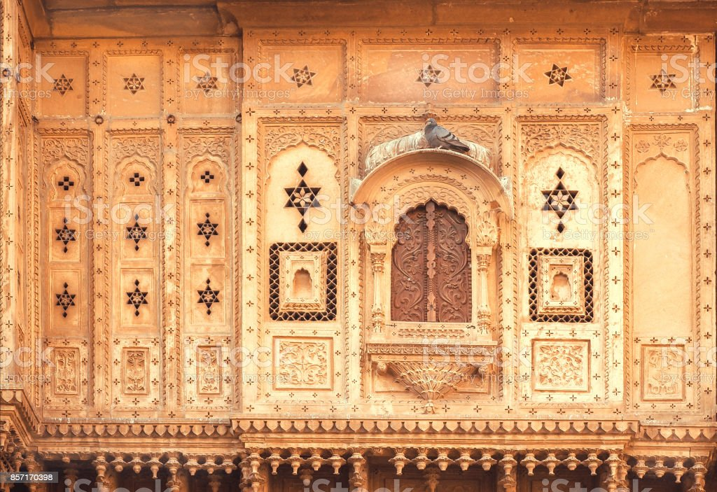 Closed window of an old house with carvings on walls. Indian tradition of architecture stock photo