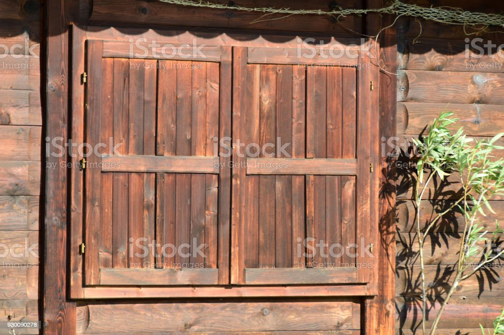 Closed window of the barn stock photo