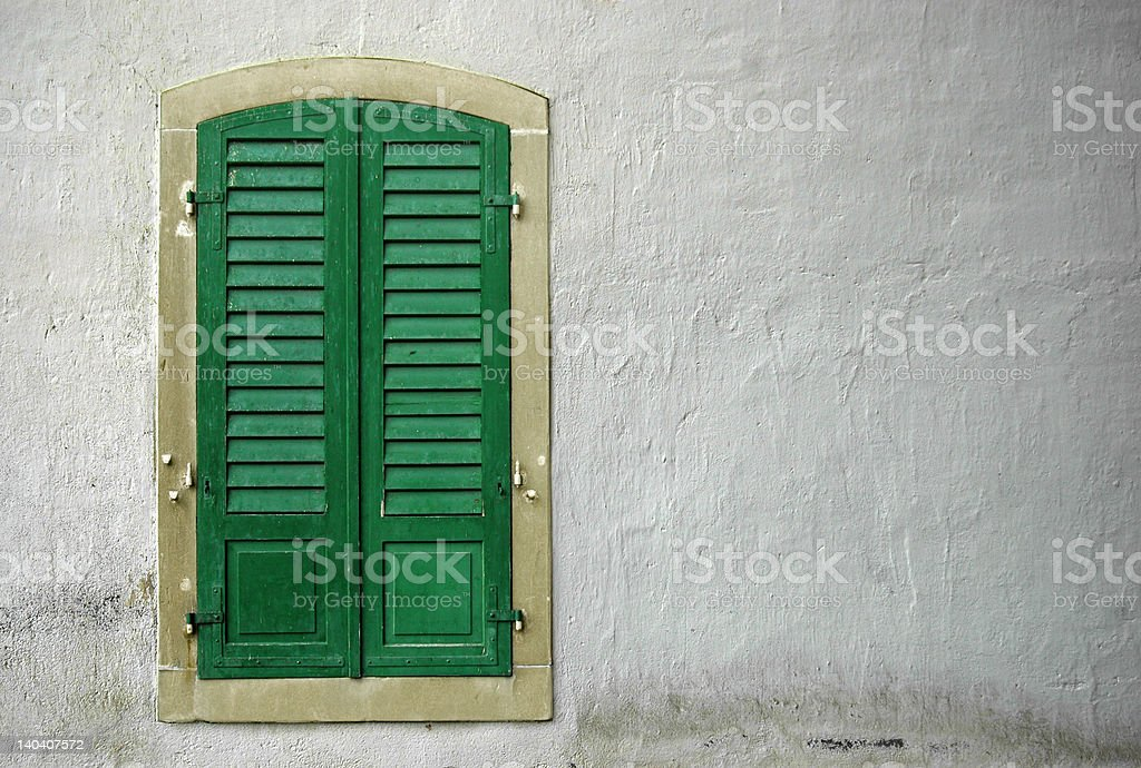 closed window on a white wall stock photo