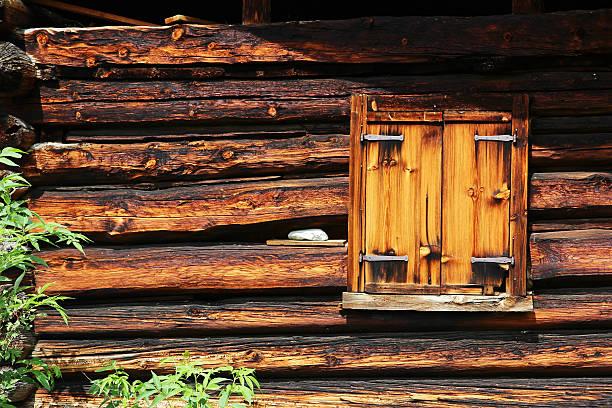 Closed window on an old farmhouse stock photo