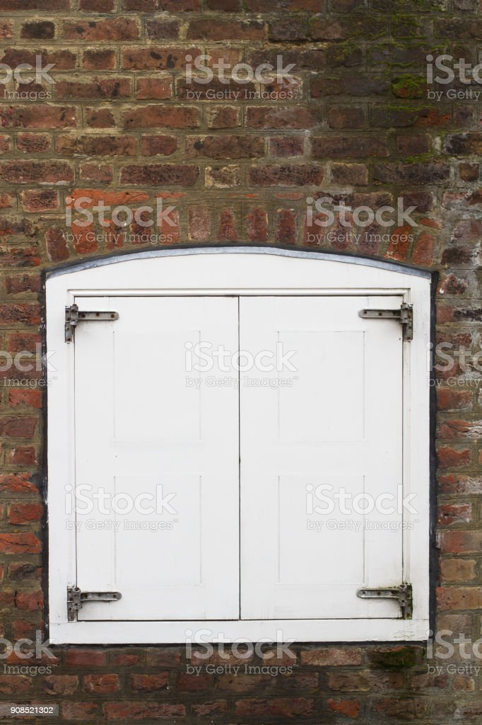 closed window with wooden blinds stock photo