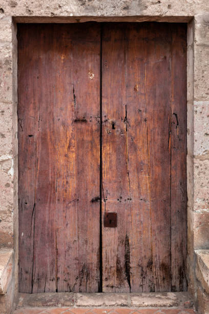 closed wooden and ancient door stock photo