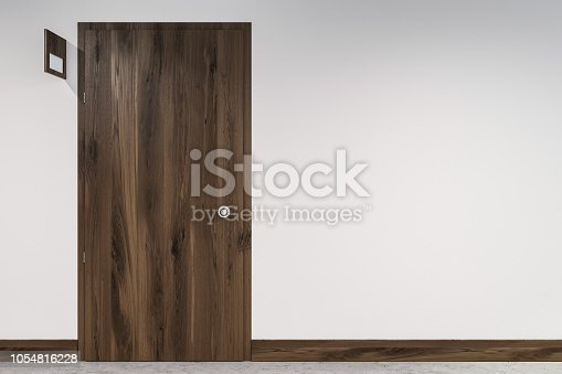 Closed wooden door with a door sign near it on a white wall. A hotel or a business center interior. 3d rendering mock up