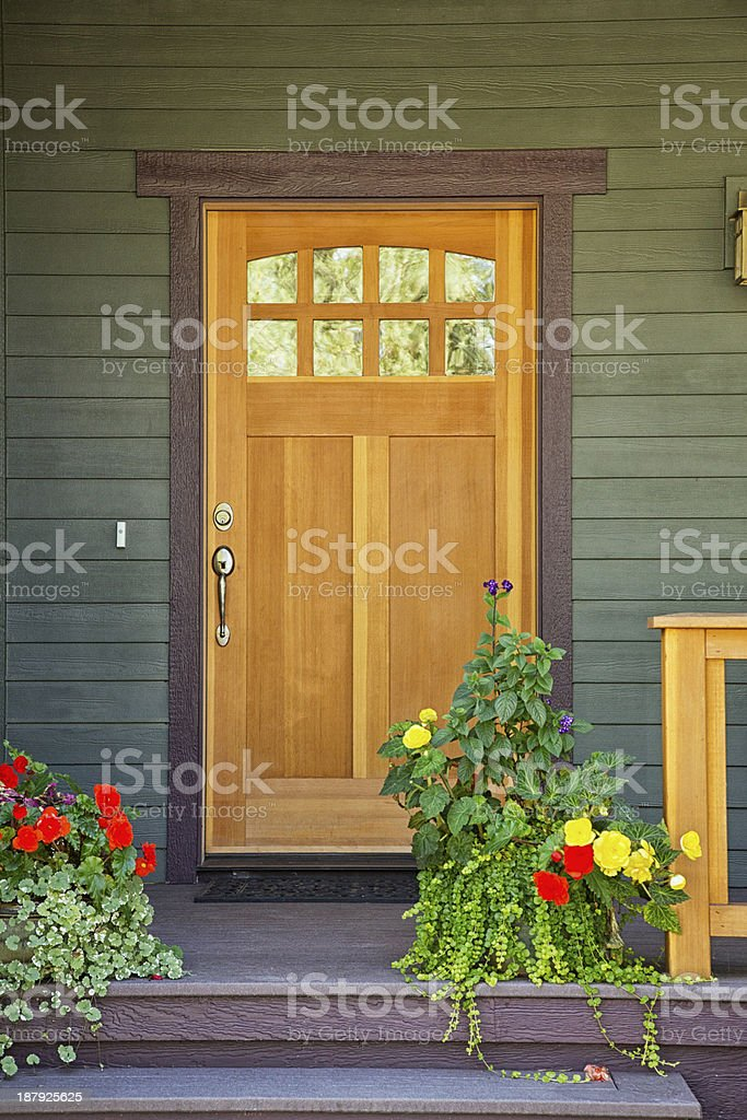 Closed wooden door of a home royalty-free stock photo