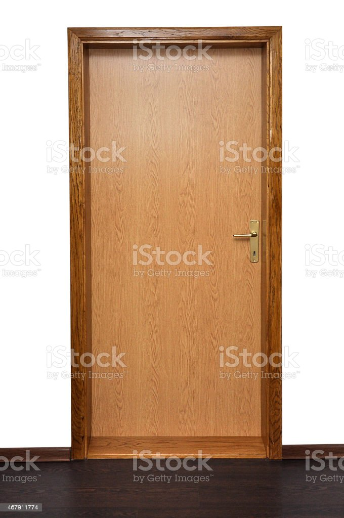 Closed wooden door on a white wall stock photo