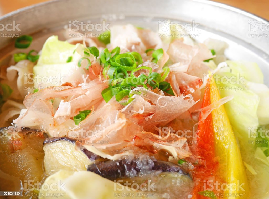 Closed-up healthy Japanese vegetable soup with sliced Skipjack tuna stock photo