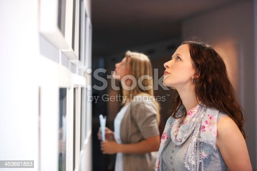 istock Closely examining the elements of a painting 453661853