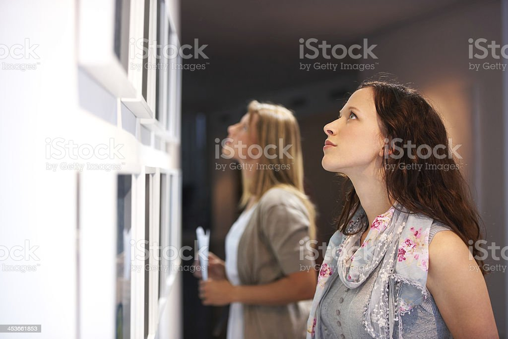 Closely examining the elements of a painting stock photo