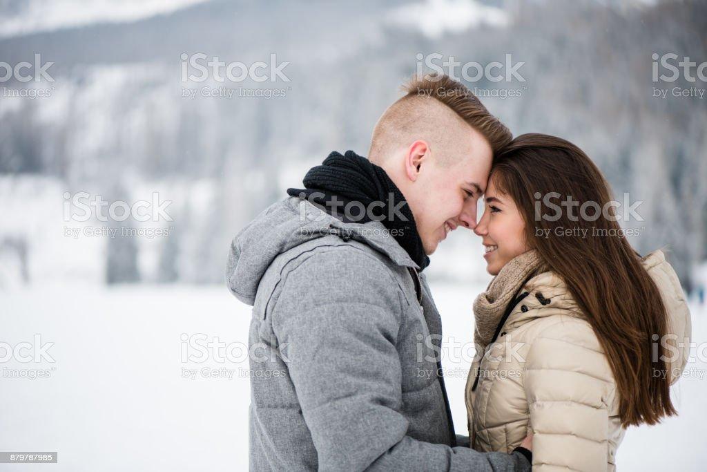Closeness of romantic smiling teenage couple stock photo