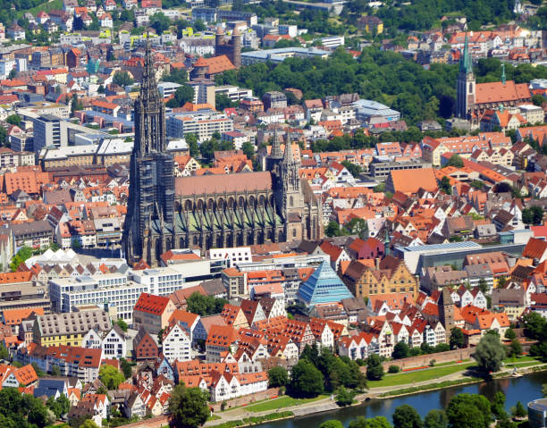 Closer Aerial view of Ulm Minster (Ulmer Münster) and Ulm, south germany on a sunny summer day Closer Aerial view of Ulm Minster (Ulmer Münster) and Ulm, south germany on a sunny summer day ulm minster stock pictures, royalty-free photos & images