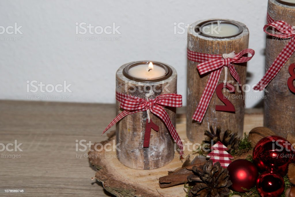 closer view on the first burning candle at a wooden special advents...
