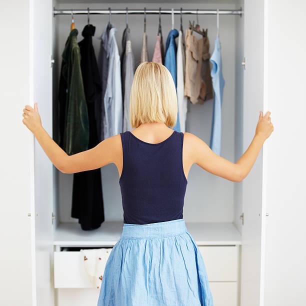 closet full of choices - looking inside inside cabinet bildbanksfoton och bilder