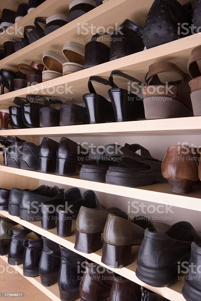 Closet Shoes Organization with Shelves and Racks in Storage Room stock photo