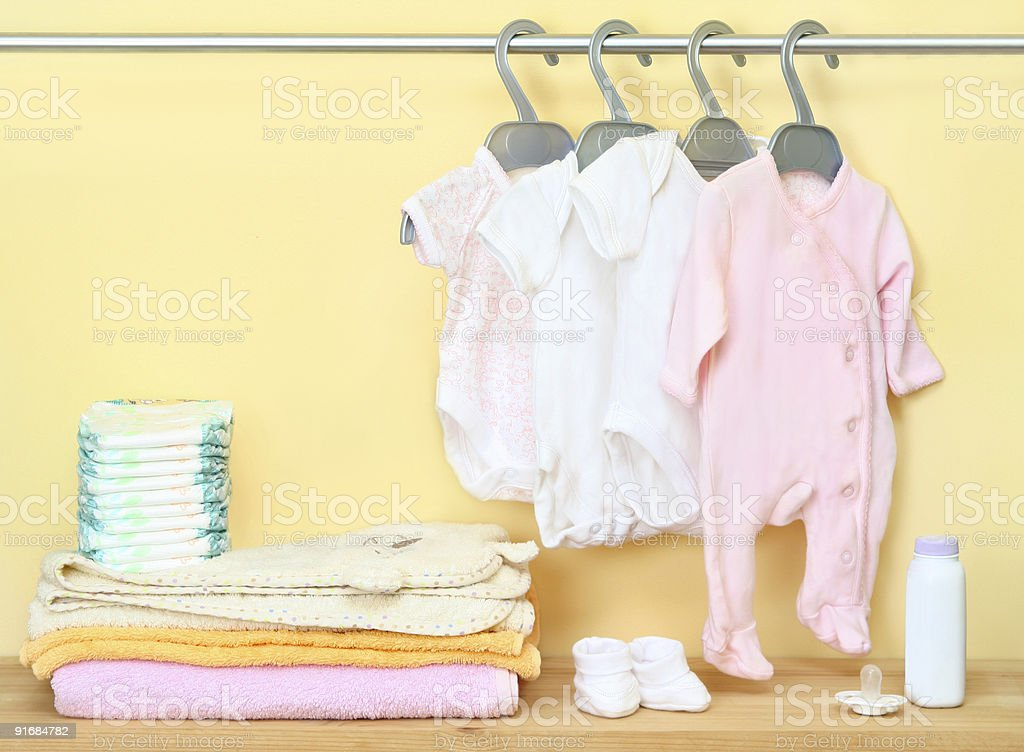 Closet with cute clothes and accessories for newborn stock photo