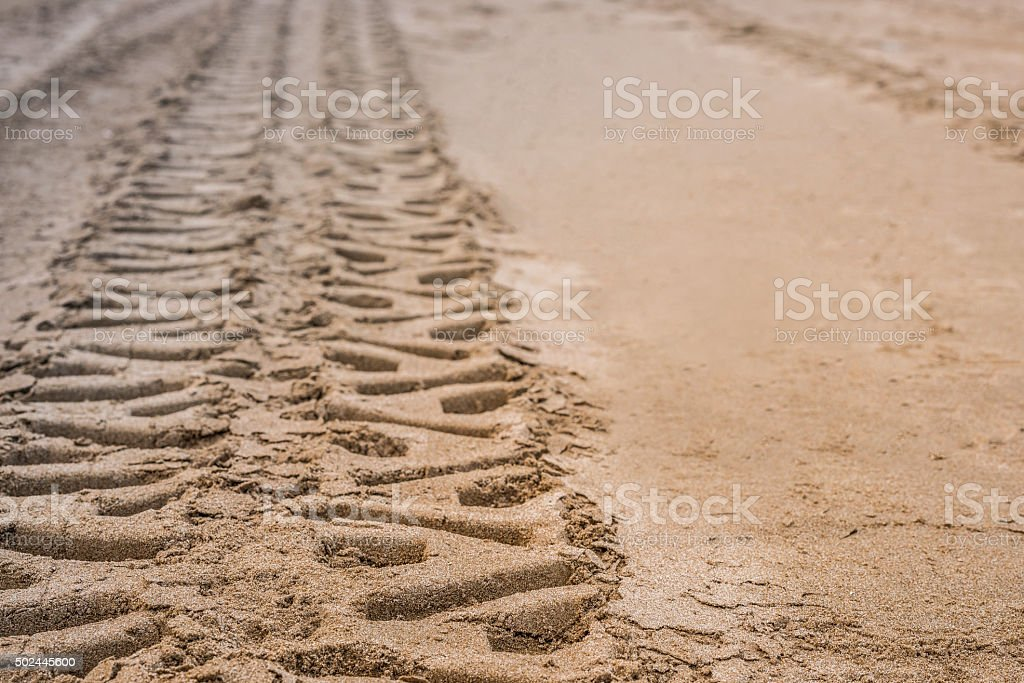 Closeup 4wd tyre track on the beach stock photo