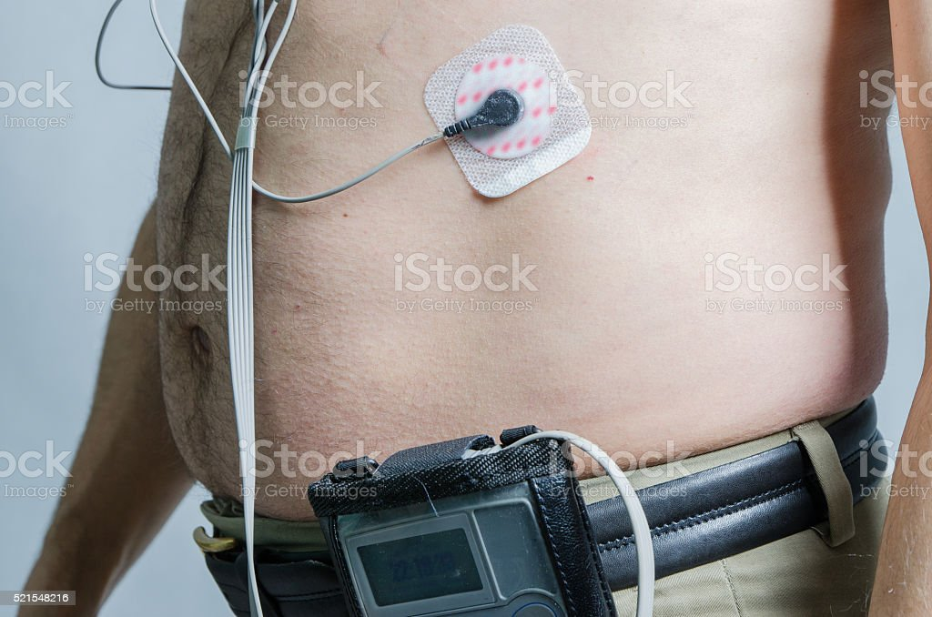 Close-up 50 year-old man with sensors with holter monitor stok fotoğrafı