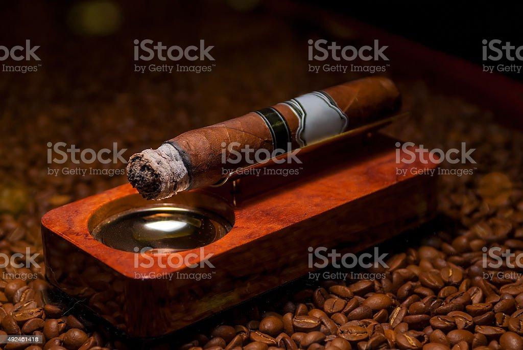closeup a cigarette in the ashtray stock photo