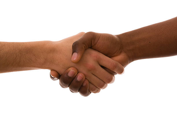 Close-up a handshake against a white background stock photo