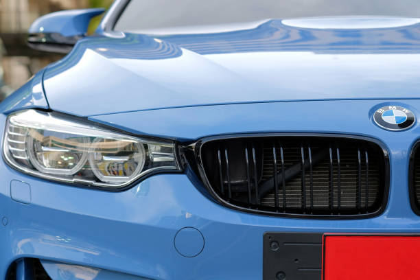 Close-up a headlight of BMW M4 sport blue car stock photo