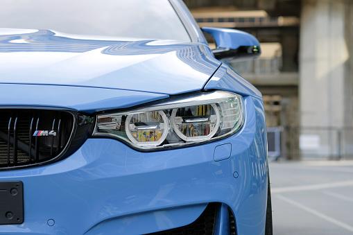 Bangkok-Thailand SEP 9 2017: Close-up a headlight of BMW M4 sport blue car in Bangkok, Thailand on daytime