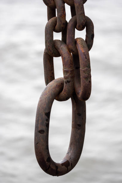 Close-up, a heavy anchor hangs on the ship stock photo