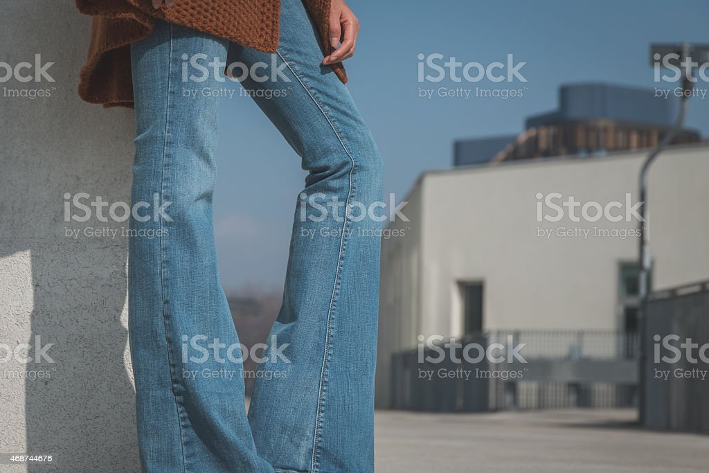 Close-up a woman's legs posing in jeans in the city stock photo
