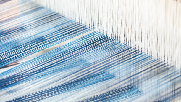 closeup, abstract motion blur of silk fabric weaving - 짜기 뉴스 사진 이미지