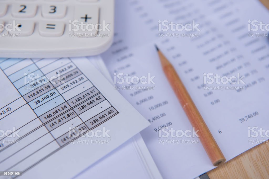 closeup accounts number on a printed paper ,Calculator and pencil. stock photo
