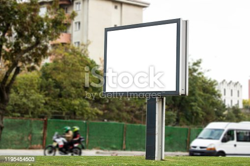istock Close-up advertising sign. In white background. Photographed on a autumn day. 1195454503