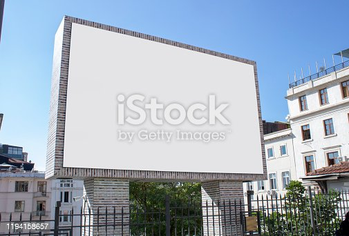 istock Close-up advertising sign. In white background. Photographed on a summer day. 1194158657