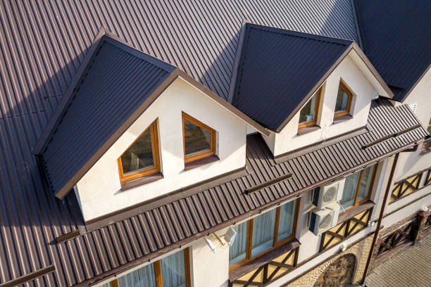 Close-up aerial view of building attic rooms exterior on metal shingle roof, stucco walls and plastic windows. Close-up aerial view of building attic rooms exterior on metal shingle roof, stucco walls and plastic windows. metal stock pictures, royalty-free photos & images