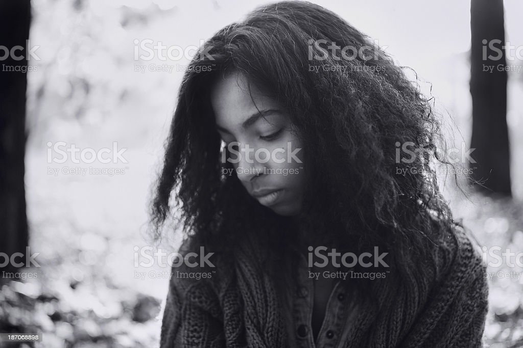 Close-up african descent woman in autumn forest. stock photo