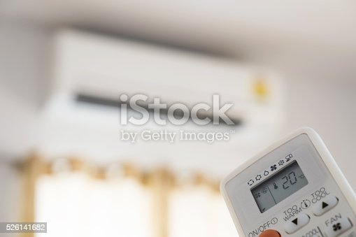 istock Close-up air condition remote, controlling temperature 526141682